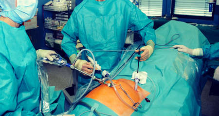 Surgeons working on a patient in a operating theater