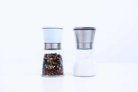 spice mills with salt and pepper in front of white background Stock Photo