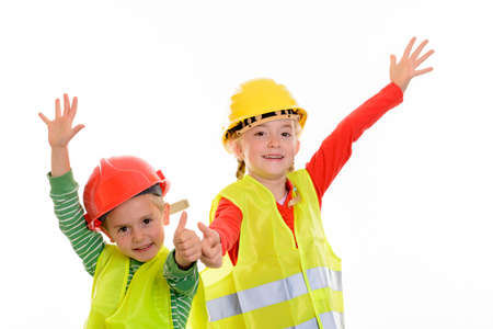 boy and girl with reflective vest and helmet in front of white background Stok Fotoğraf