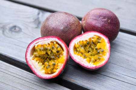 passion fruit halved and closed on wooden ground Stok Fotoğraf