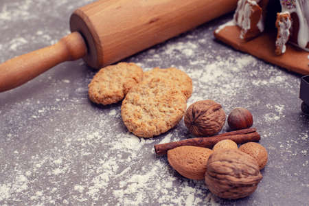 christmas decoration with rolling pin,cinnamon, nuts and cookies Stock Photo
