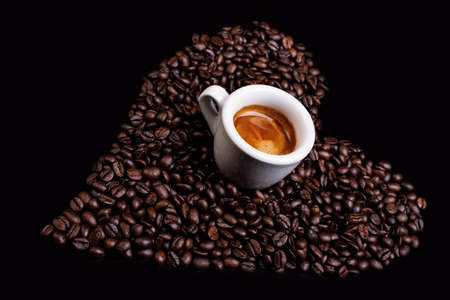 heart of coffee beans with espresso cup Stock Photo