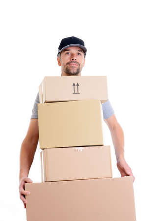 overstrained postman with parcels in front of white background Standard-Bild