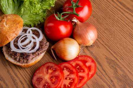 home made hamburger with meat, onion and tomato