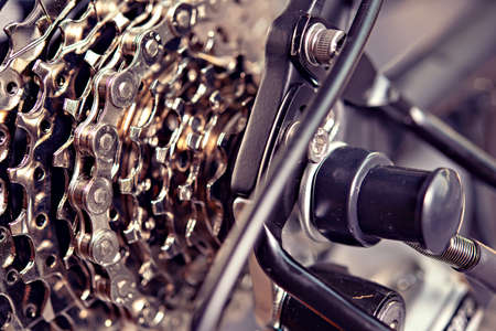 close up of  a glossy  bicycle gear and black electric motor