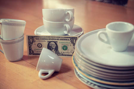 older dishes set with money on the floor in living room