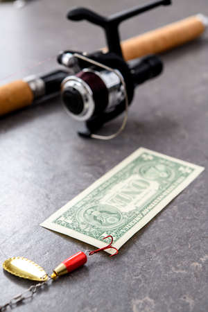 fishing rod and euro  money on gray floor 免版税图像