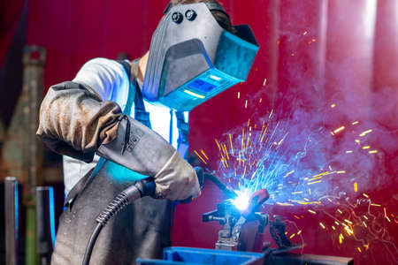 man welding metal in the factory Фото со стока