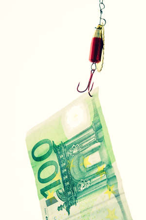 fishhook with euro note in front of white background