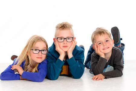 three happy children in front of white background