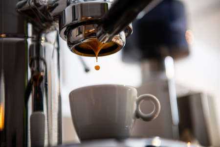 porta filter espressomachine in front of bright background