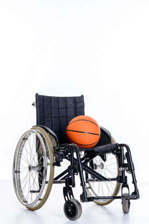 wheelchair with ball in front of white background Banco de Imagens
