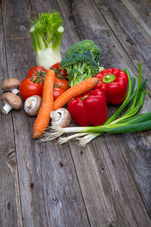 different vegetables on wooden ground