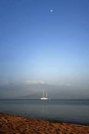 Maui Sunrise With Sailboat Stock Photo