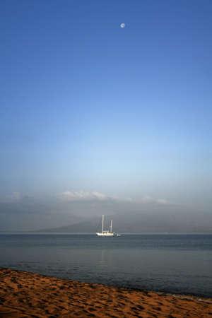 Maui Sunrise With Sailboat Stock Photo