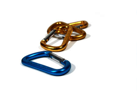 rapelling: Carabiners - three gold one blue Stock Photo