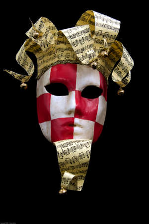 Red & white checkered carnival mask black background