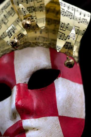 Red & white checkered carnival mask black background