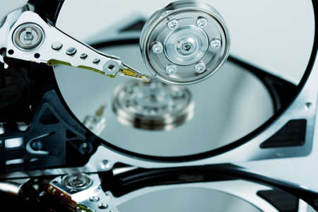 Close-up of hard drives needle and platter with reflection