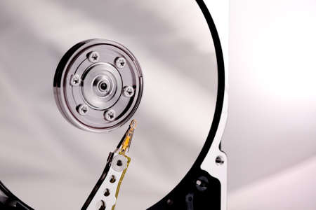 Close-up of hard drives needle and platter in the case