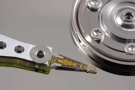 Close-up of a hard drive needle with reflection top view photo