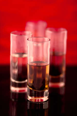 Shot glasses lined up ready to drink  Stock Photo
