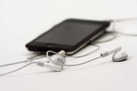 Handphones with a digital music player on a white background