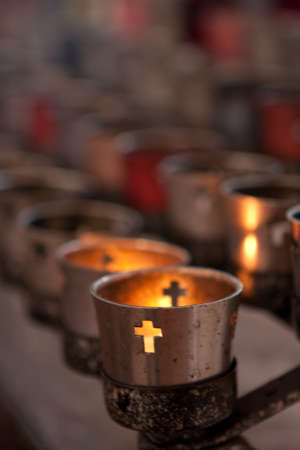 Candle burning in a church