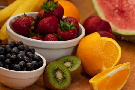 Mixed fruit kiwi, strawberrys, oranges, and more Stock Photo - 7464471
