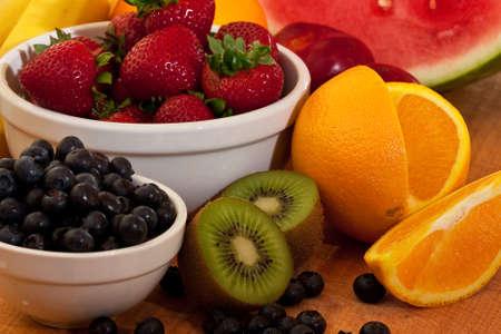 Mixed fruit kiwi, strawberrys, oranges, and more photo