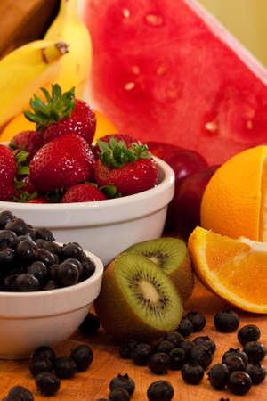 Mixed fruit kiwi, strawberrys, oranges, and more Stock Photo - 7464472