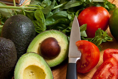 Mixed vegetables avocados, tomatoes, and basil Stock Photo - 7485496