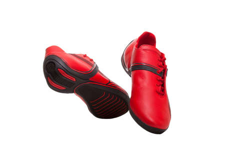 Red and black sport shoes isolated on white