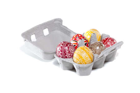 A carton of hand painted decorative eggs