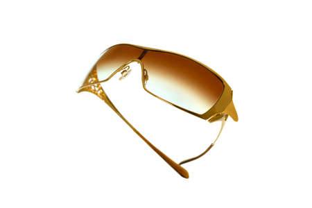 A pair of very stylish gold sunglasses Stock Photo - 9430747