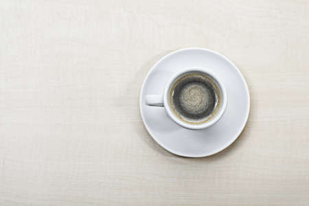 A cup of espresso on a table