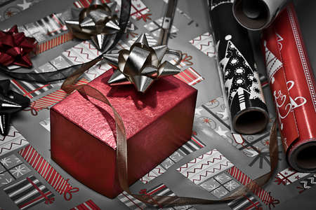 Red box with bow and wrapping paper in the background Stock Photo - 11135076
