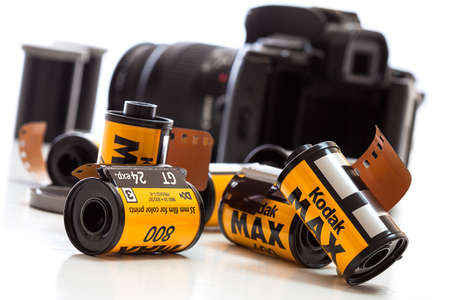 Rolls of Kodak film with a camera