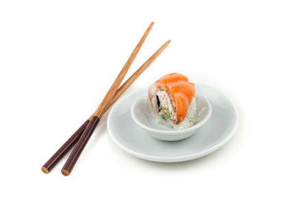 Salmon sushi on a plate with chopsticks on the side