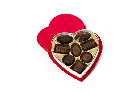 box size: Heart shaped box with chocolates on white background Stock Photo