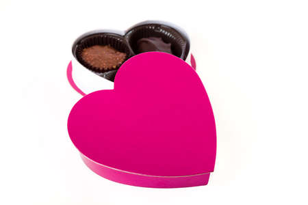Pink Valentine s Day Heart with Chocolates Stock Photo