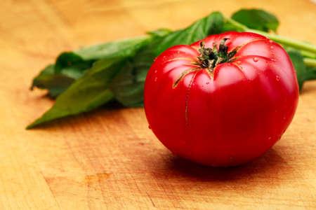 Ripe Tomato and Fresh Basil On Cutting Board