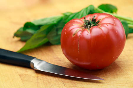 Tomato Basil And Knife On Cutting Board