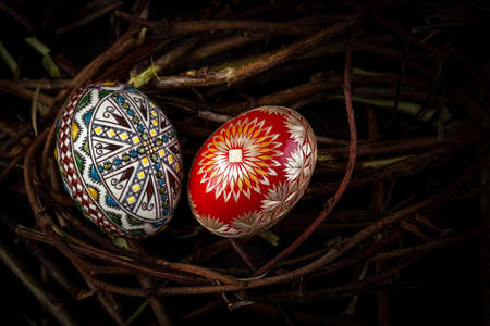 Colorful and beautifully designed eggs in a nest Stock Photo
