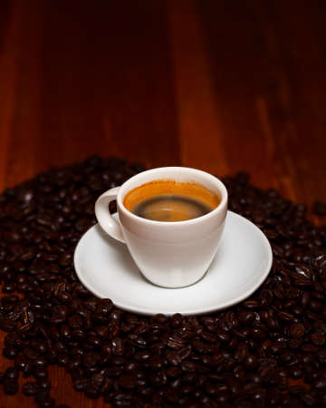 Cup Of Espresso And Beans On A Wooden Table Stock Photo
