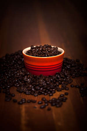A Bowl Of Coffee Beans On A Wood Table Stock Photo