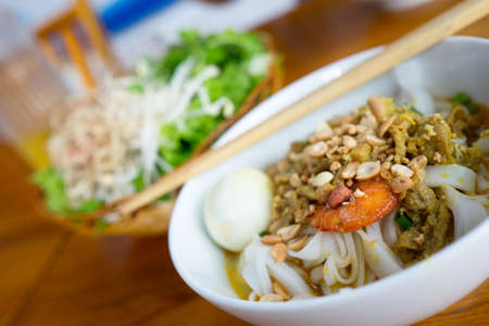 heathy diet: A bowl of Noodle with Pork, Shrimp, vegetables, and Egg (My Tom Thit Trung)
