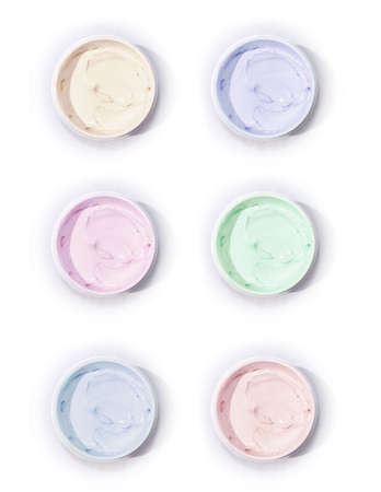 waxes: Pastel Creams in Jars on White Background Stock Photo