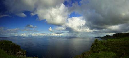 rain shower: Kilt rock viewpoint rain shower and rainbow