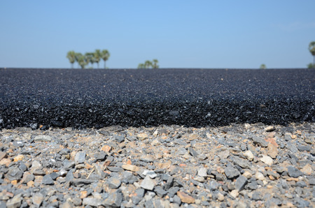 New asphalt road surface paving gravel roads. photo